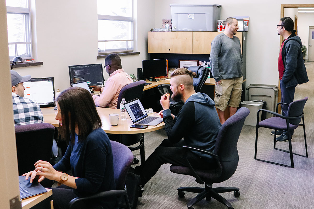 The JMG team working inside their office.